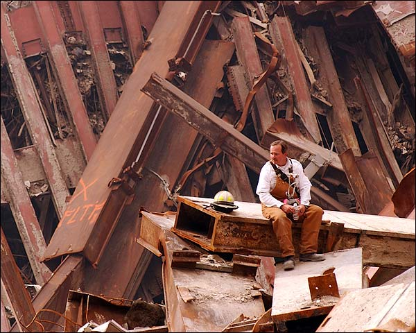 Firefighter Sitting on Metal Beam 9/11 Photo Print for Sale