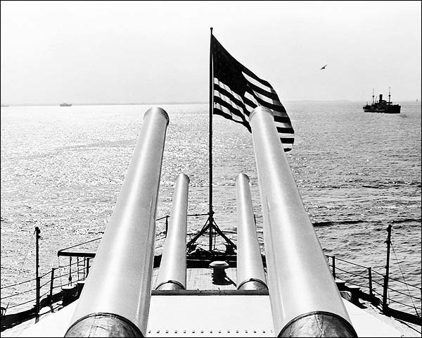 WWII Battleship Guns and Flag Scan the Sea Photo Print for Sale