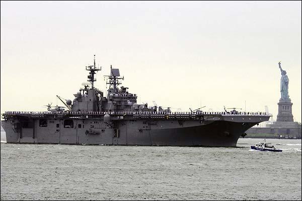 USS Iwo Jima Sailing Past Statue of Liberty Photo Print for Sale