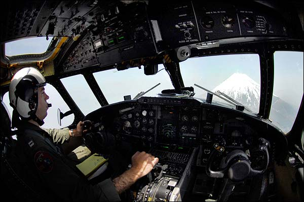 Grumman C-2A Greyhound Pilot in Cockpit Over Mount Fuji Photo Print for Sale
