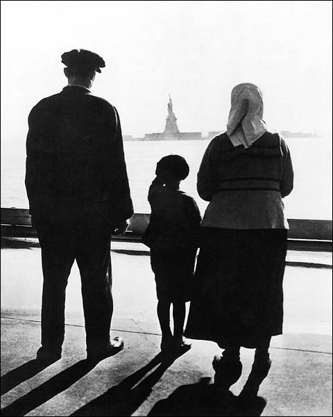 Immigrants at Battery Park Look Toward Statue of Liberty Photo Print for Sale